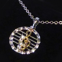 Necklace Dangling Treble Clef Design With Crystals